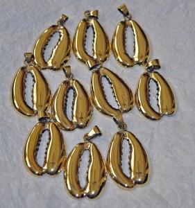 brass cowrie shells