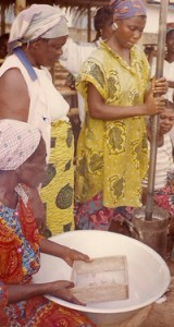 Women pounding glass into powder and sifting