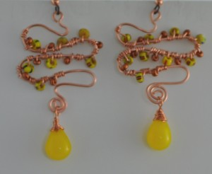 Copper wrapped swirls and Fulani wedding bead earrings